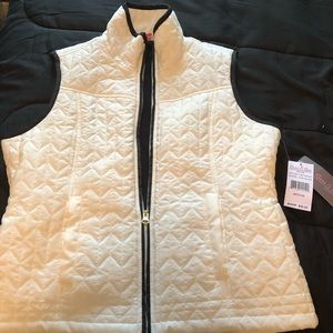 White and black vest